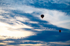 Colorful hot air balloon is flying at sunrise Royalty Free Stock Photos