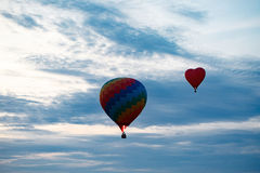 Colorful hot air balloon is flying at sunrise Royalty Free Stock Image