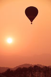 Colorful hot air balloon is flying at sunset Royalty Free Stock Images