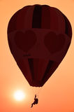 Colorful hot air balloon is flying at sunset Royalty Free Stock Image
