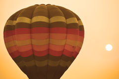 Colorful hot air balloon is flying at sunset Royalty Free Stock Photos