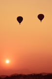 Colorful hot air balloon is flying at sunset Stock Image