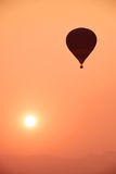 Colorful hot air balloon is flying at sunset Stock Photo