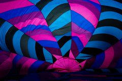 Inside A hot air ballon while it is being blown up. A colorful hot air balloon while on the ground being blown up royalty free stock image