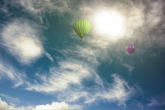 Colorful hot air balloon high in the sky Royalty Free Stock Photos