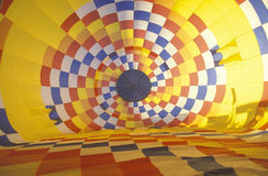 Colorful hot air balloon inflating Royalty Free Stock Images