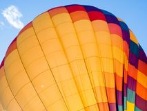 Colorful hot air balloon inflating. Colorful hot air balloon on the ground ready to take off - at Winthrop Balloon Festival, Washington state Stock Photography