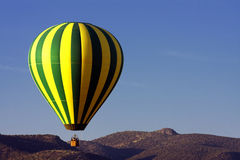 Colorful Hot Air Balloon Over The Arizona Desert Stock Photography