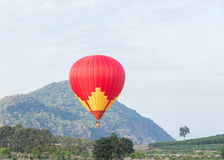 Colorful hot air balloon. Over mountain landscape Royalty Free Stock Image