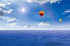 Colorful hot air balloon over the sea Royalty Free Stock Photography