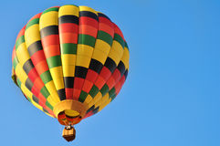 Colorful hot air balloon in the sky. Beautiful scene with hot air balloon in the blue sky Stock Photo