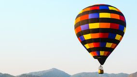 Colorful hot air balloon with sky and mountain background, with copy space for your text stock photography