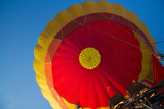 Colorful hot-air balloon in the sky with open fire royalty free stock images