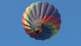 Colorful hot air balloon taking off stock video footage