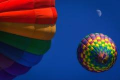 Colorful hot air balloons. Underside view of colorful hot air balloons flying in blue sky, Citrus Class Balloon Festival, Santa Paula, California Stock Images
