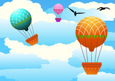 Hot air balloons. Colorful hot air balloons against a cloudy sky Royalty Free Stock Photography