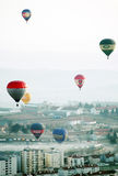 Colorful Hot Air Balloons in the Air, Foggy Morning Stock Photography