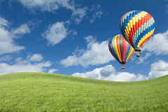 Colorful Hot Air Balloons In Beautiful Blue Sky Above Grass Field Royalty Free Stock Photos