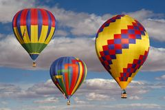 Colorful Hot Air Balloons in a Cloudy Sky Stock Image