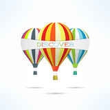 Colorful hot air balloons with discovery word banner. Travel and discover concept Stock Photos