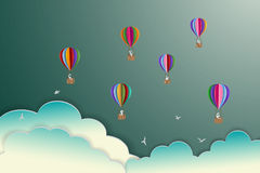 Colorful hot air balloons floating on the sky,paper art style Royalty Free Stock Photography
