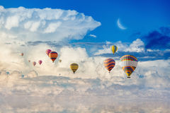 Colorful hot air balloons flying blue sea stock photo