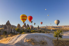 Colorful hot air balloons flying over ancient valleys Royalty Free Stock Photo