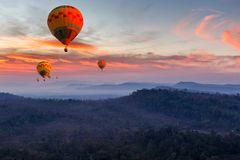 Colorful hot air balloons flying over mountain at Pakse. Laos Royalty Free Stock Images