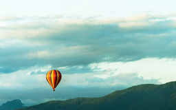 Colorful hot-air balloons flying over the mountain Stock Image