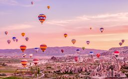 Colorful hot air balloons flying over rock landscape at Cappadocia Turkey.  stock images
