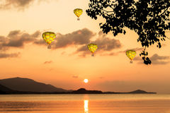 Colorful hot-air balloons flying over the sea. Colorful hot-air balloons flying Royalty Free Stock Image