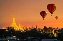 Colorful hot-air balloons flying over of Shwedagon Pagoda at Yan Royalty Free Stock Images