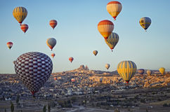 Colorful hot air balloons flying over the valley Royalty Free Stock Photos