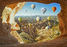 Colorful hot air balloons flying over the valley at Cappadocia Stock Photo
