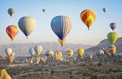 Colorful hot air balloons flying over the valley at Cappadocia Royalty Free Stock Photos