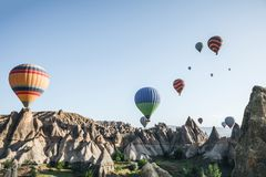 colorful hot air balloons flying in sky above beautiful goreme national park, cappadocia, turkey В  royalty free stock photos