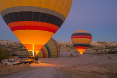 Colorful hot air balloons inflating before the flight Stock Photos