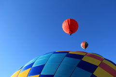 Colorful hot air balloons overhead Royalty Free Stock Photo