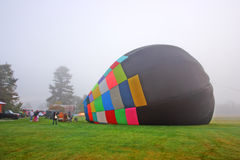 Colorful Hot air balloons preparing for flight in Vermont.  Royalty Free Stock Photo