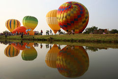 Colorful hot air balloons reflected in the water stock photos