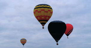 Colorful hot air baloons at a festival stock video footage