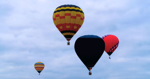 Colorful hot air baloons flying. In summer Royalty Free Stock Photography