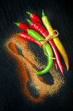 Colorful hot chili peppers on a chalkboard Stock Photo