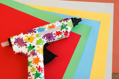 Colorful Hot Glue Gun and Paper Stock Image