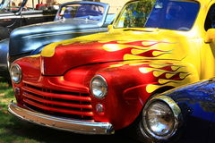 Colorful hot rod classic cars. Classic car displayed at a car show Royalty Free Stock Images