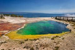 Colorful hot spring, Lake Yellowstone in the background, Yellowstone national park. USA stock photos