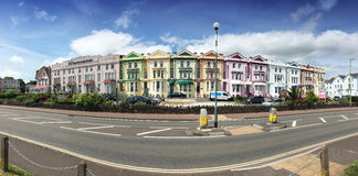Colorful hotels on the seafront in Paignton Devon UK. Panoramic view of colorful gast houses or hotels in Paignton Devon UK Royalty Free Stock Images