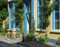 Colorful house. With a bicycle in front Stock Photo