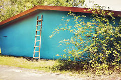 Colorful house. Blue house and stairs in a garden Stock Photography