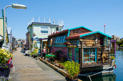 Colorful house boats at Fisherman's Wharf in  Victoria, BC. The house boats moored at Fisherman's Wharf are a hidden treasure just steps from the Inner Harbour Royalty Free Stock Photos